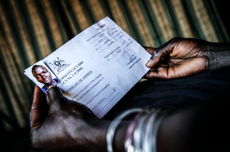 Female former child soldier and her amnesty certificate