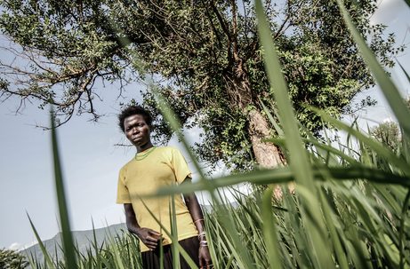 Female former child soldier showing the spot where she was abducted by the LRA
