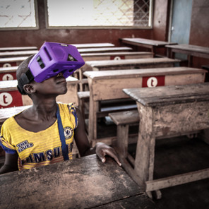 Street kid playing with VR headset