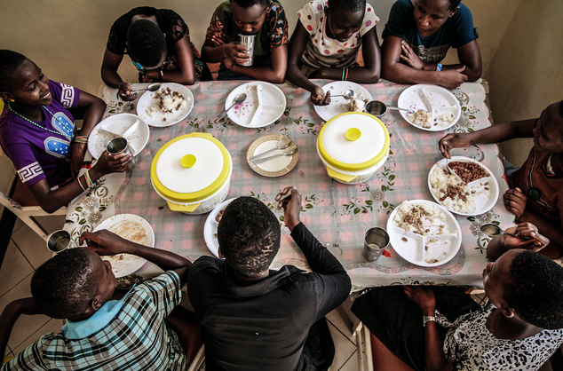 Young girls enjoy lunch at a safe house