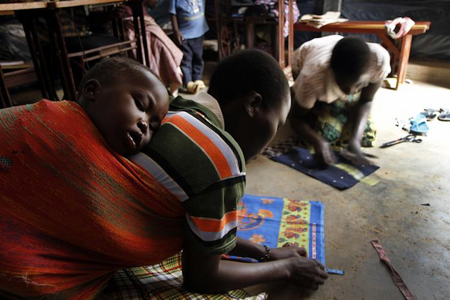 Female former child soldiers are taught how to become tailors