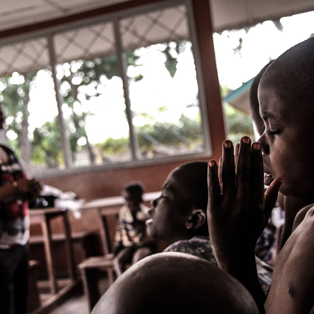 Street kids pray and sing at safe house