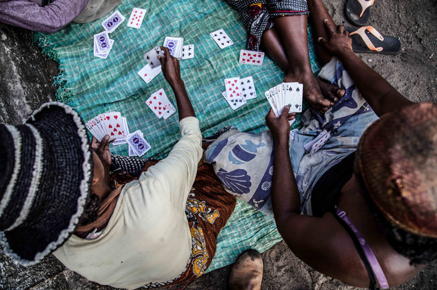 Fenale prisoners kill time playing cards
