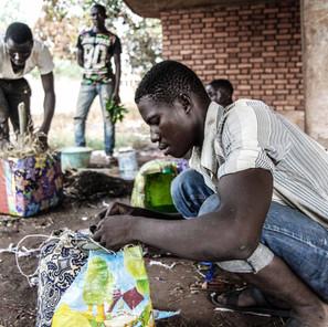 Street kids making flower arrangements to sell
