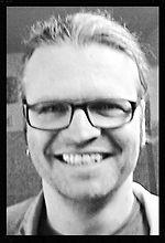 Norbert Jansen lächelt in die Pamband-Kamera