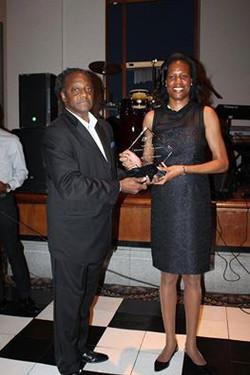 Bill Ford presents award