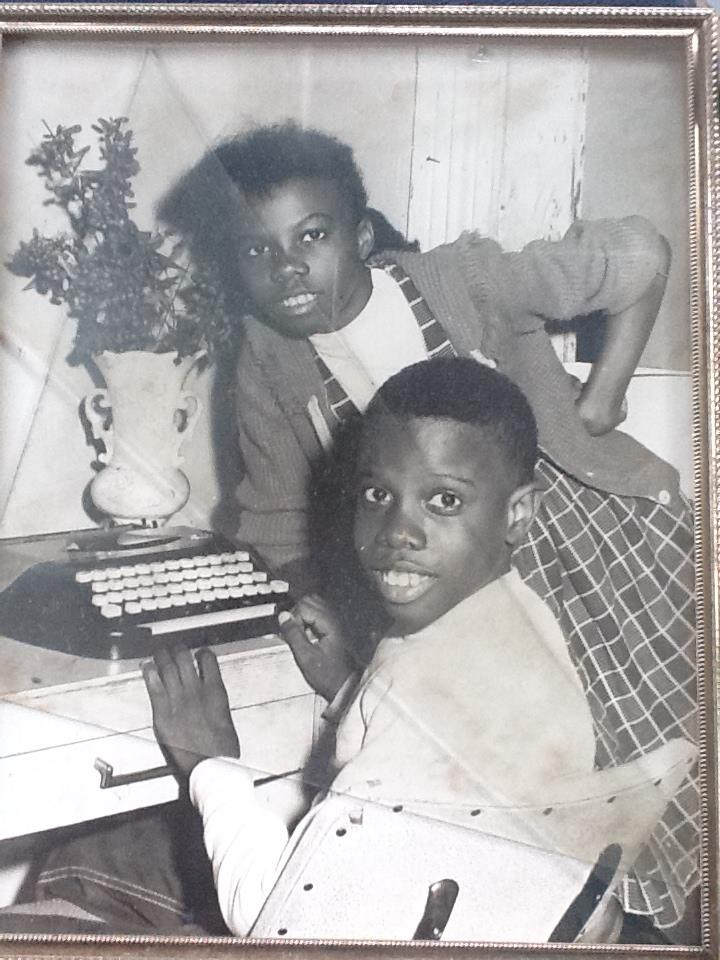 Joanne and Jr. at their desk