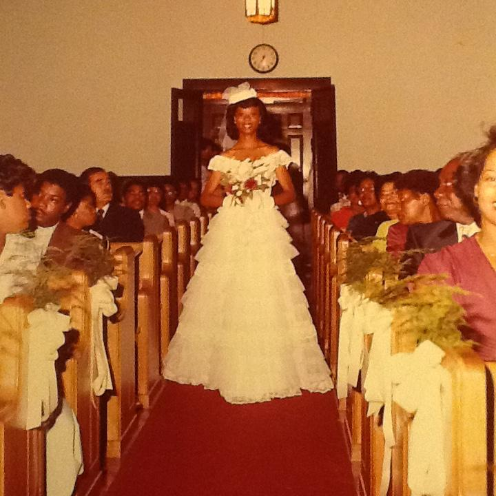Pam as a bridesmaid at age 21