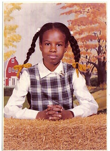 Riché Richardson's school day picture in third grade, age 8