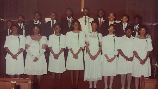 "Riché Richardson, front row, 4th from left, St. John eighth grade class graduation singing ""We Are the World"" during the ceremony in May of 1985"