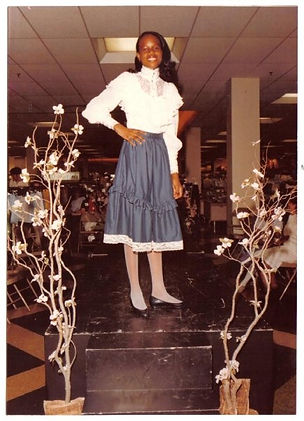 Riché Richardson, striking a pose after modeling in fashion show that culminated poise-charm classes at Gayfer Department Store in Montgomery Mall, age 11