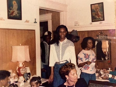 "Riché Richardson, age 15, at home with family and visitor after school on a ""Jean's Day.  Spring of 1987"