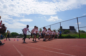 student running race at red hook track