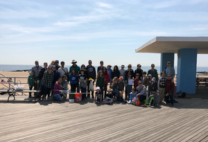 Families gathered at Coney Island boardwalk for beach clean up.