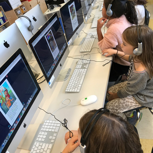 Second graders working in the computer lab