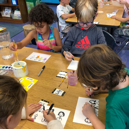 students making art together