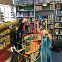 Students working in STEM centers in the Library!