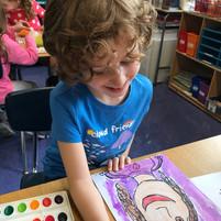 student painting self-portrait