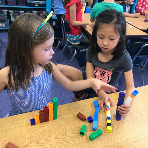 Lower grade students working in math centers