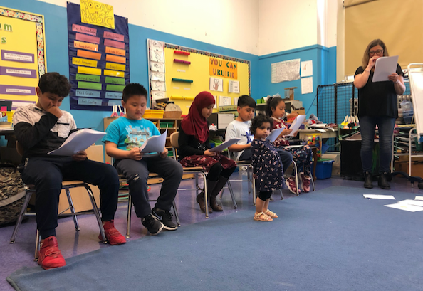 students reading from a text