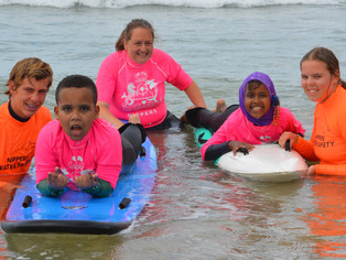 Refugee and migrant children welcomed to the surf at Anglesea