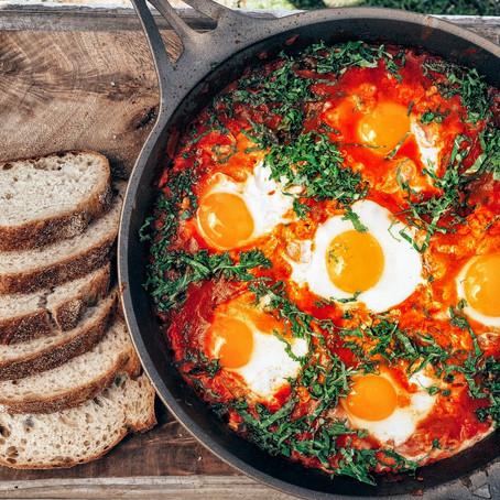 Nefeli Nine Recipe of the Month: Shakshuka (Eggs poached in spicy tomato sauce)