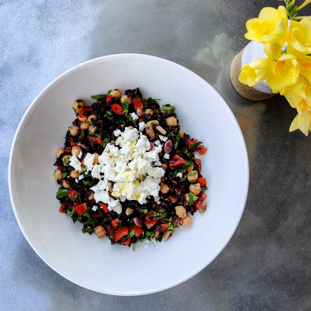 Black rice, chickpea salad topped with crumbled feta, roast pistachios and lots of herbs