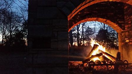 fireplace stone double sided night.jpg