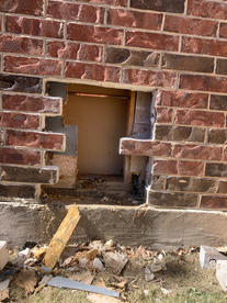 Before_ plumbing repair brick masonry wo