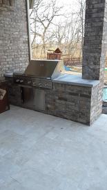 Brick grill cook station travertine deck