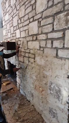 Slurry mortar on fireplace stone wall-1.