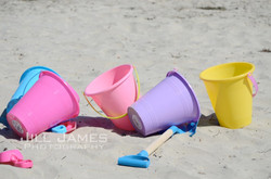 Sand Buckets On The Beach