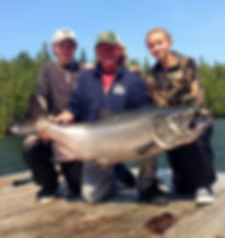 Legacy Lodge guest with kids and 50+ lb salmon