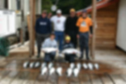 Legacy Lodge fathers with sons and coho salmon