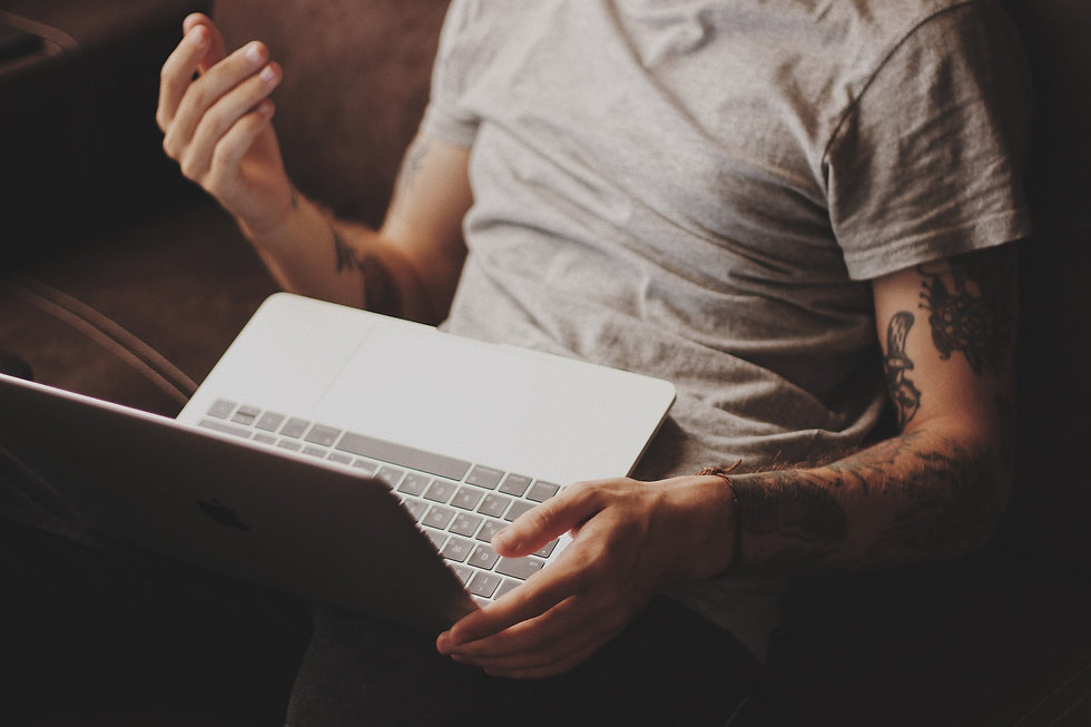 Man engaging is an online psychotherapy telehealth session