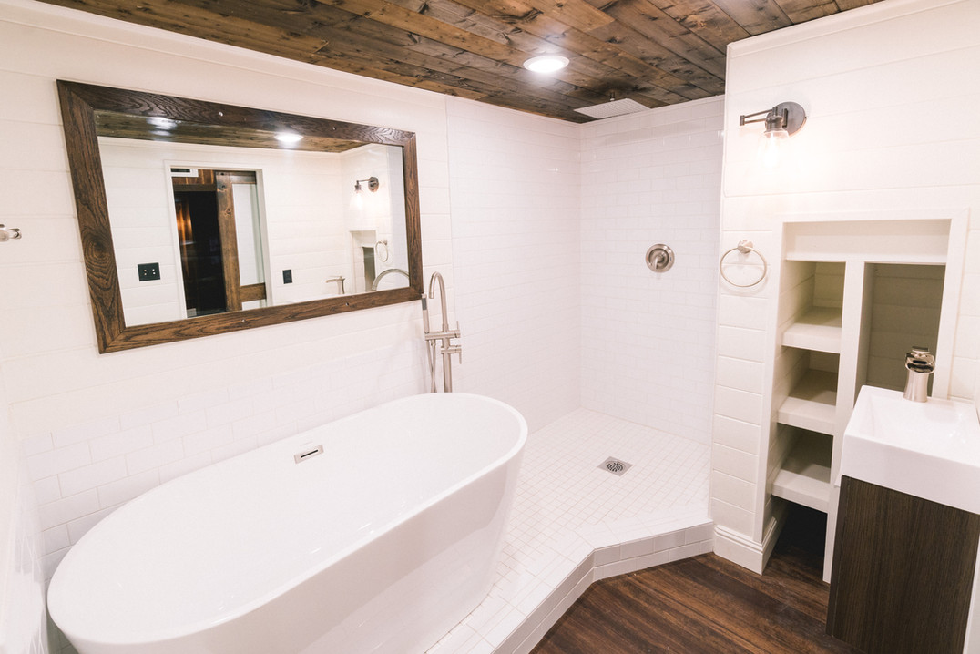 10' wide free standing tub with seperate shower tiny house bathroom.