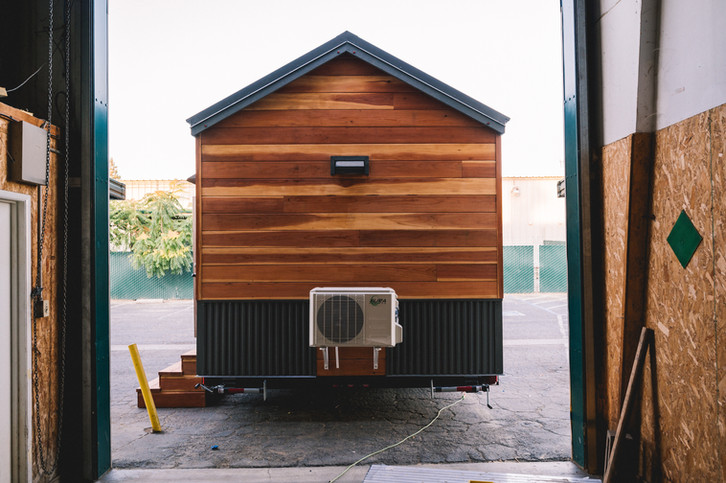 10'x 28'natural redwood and steel siding tiny house