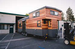 10'x 28' natural redwood and steel siding tiny house