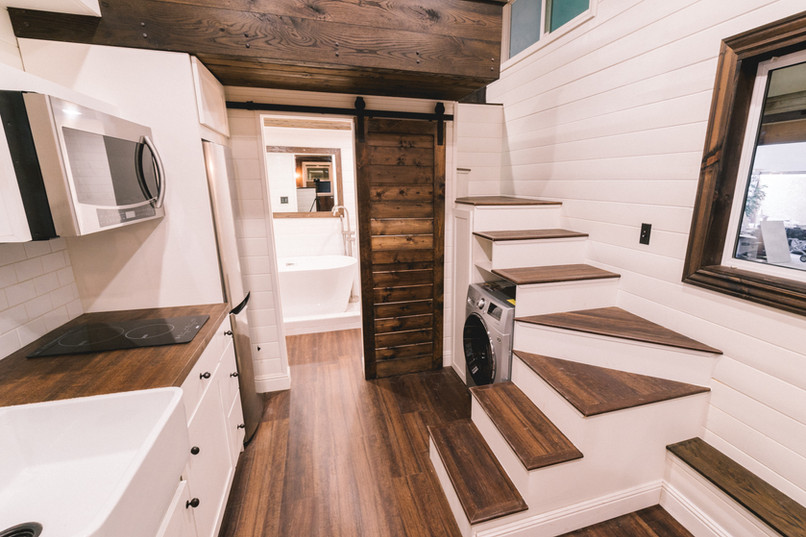 10' wide bright tiny house kitchen with wrap staircase