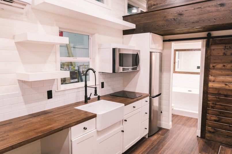 10' wide modern farmstyle light and dark contrasting kitchen