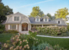 Gabled roof transformed home with hydrangea garden