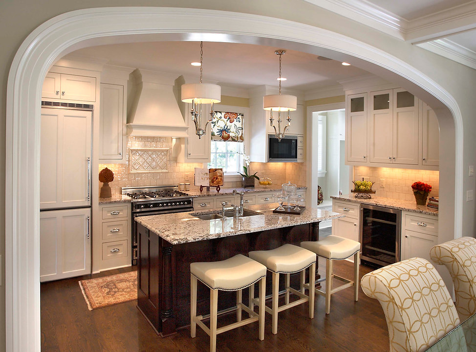 Kitchen with arched wall to living room
