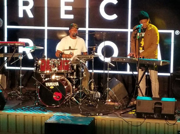 Saint and the full 100 Band playing the Rec Room