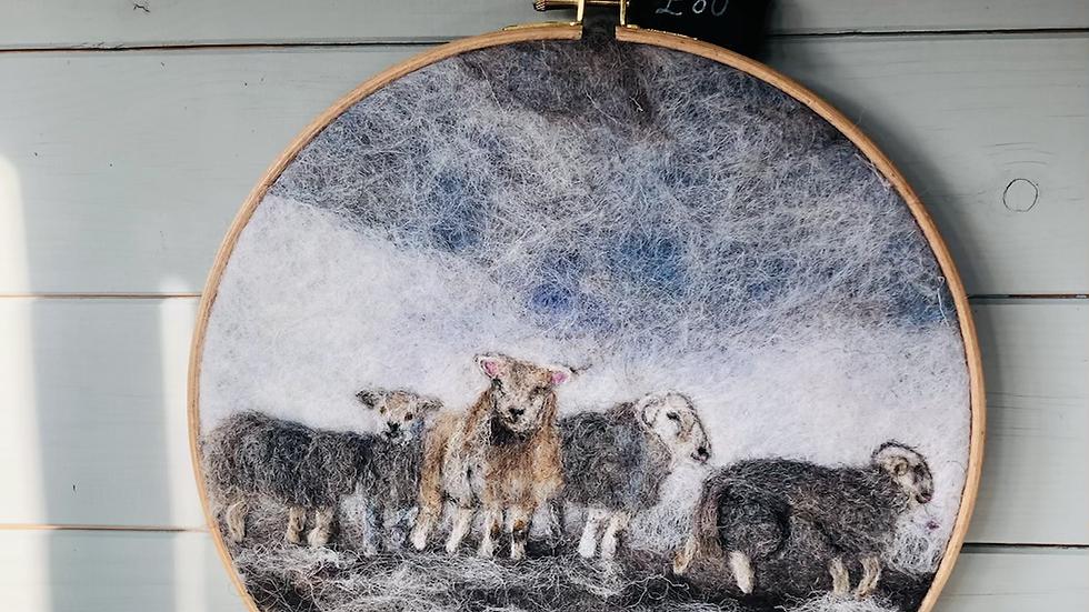 Needle felted texel and herdwicks in snow in wooden tapestry hoop