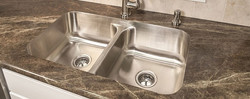ultra-modern-stainless-double-undermount-kitchen-sinks-designed-on-brown-granite