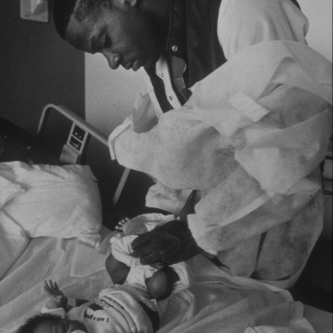 Charles Cottman changes his son's diapers