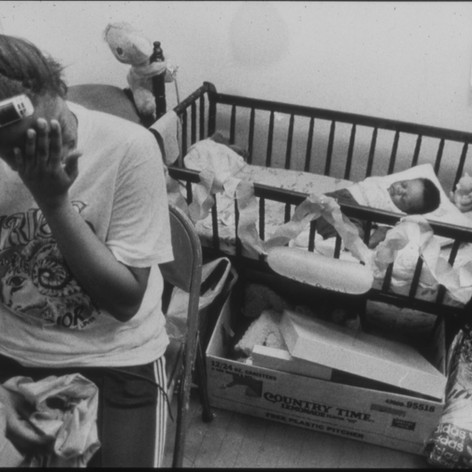 Dearie wipes perspiration from her face during her baby shower