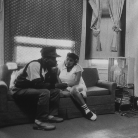 Dearie and Charles Cottman watch television together