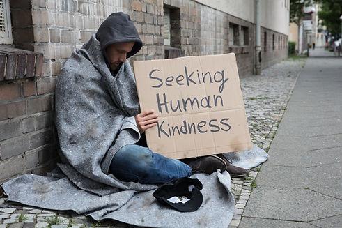 Male Beggar In Hood Showing Seeking Huma