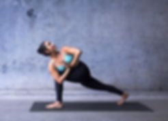 Young woman practicing yoga.jpg Parsvako